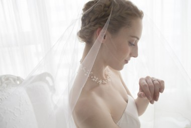 50436362 - bride wearing a wedding dress is staring at the wedding ring